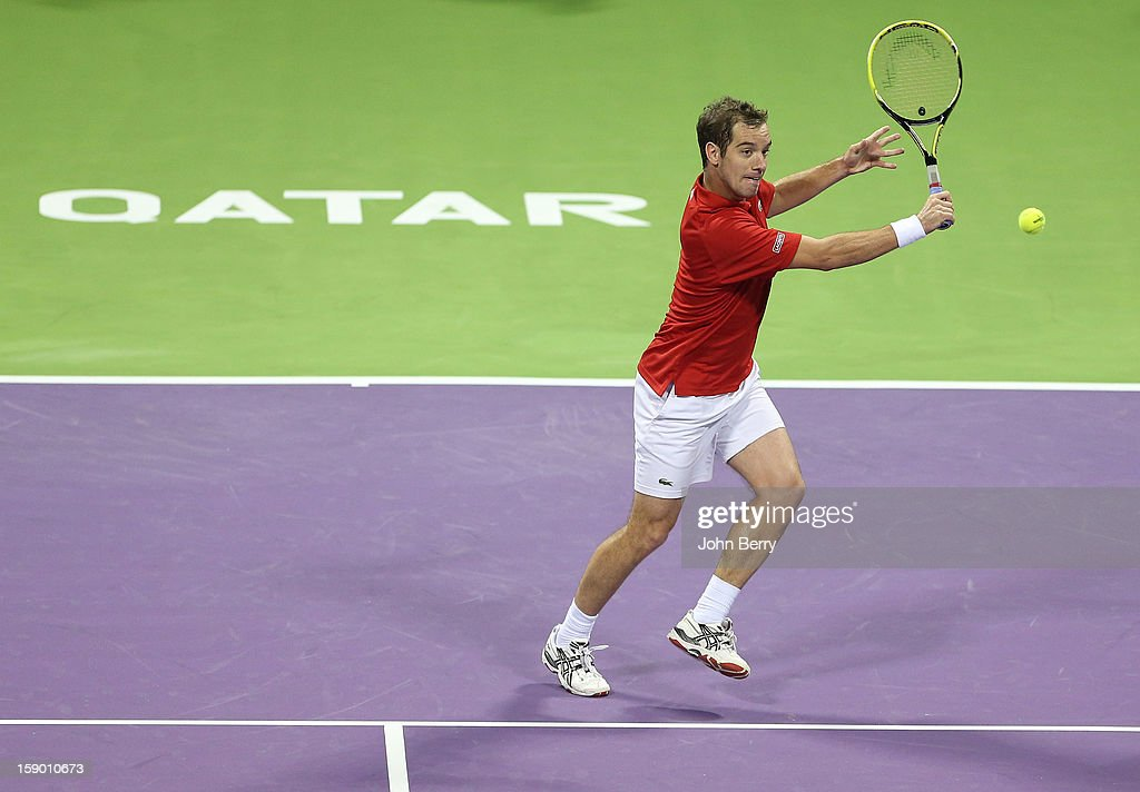 <a gi-track='captionPersonalityLinkClicked' href=/galleries/search?phrase=Richard+Gasquet&family=editorial&specificpeople=206501 ng-click='$event.stopPropagation()'>Richard Gasquet</a> of France plays a backhand volley during the final against Nikolay Davydenko of Russia in day six of the Qatar Open 2013 at the Khalifa International Tennis and Squash Complex on January 5, 2013 in Doha, Qatar.