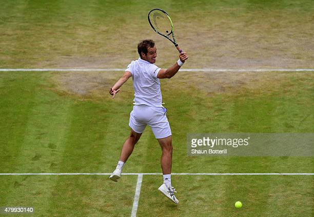 Richard Gasquet of France plays a backhand volley in his Gentlemens Singles Quarter Final match against Stanislas Wawrinka of Switzerland during day...