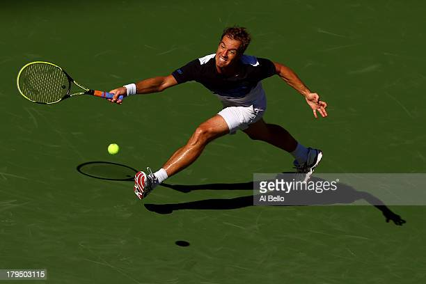 Richard Gasquet of France plays a forehand during his men's singles quarterfinal match against David Ferrer of Spain on Day Ten of the 2013 US Open...