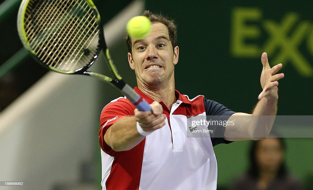 Richard Gasquet of France plays a forehand during his semi-final against Daniel Brands of Germany in day five of the Qatar Open 2013 at the Khalifa International Tennis and Squash Complex on January 4, 2013 in Doha, Qatar.
