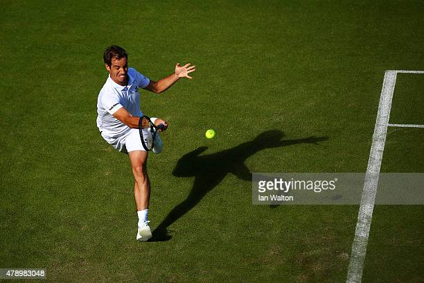 Richard Gasquet of France plays a forehand in his Gentlemen's Singles first round match against Luke Saville of Australia during day one of the...