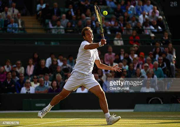 Richard Gasquet of France plays a forehand volley in his Gentlemens Singles Quarter Final match against Stanislas Wawrinka of Switzerland during day...