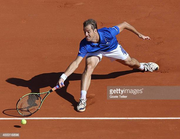 Richard Gasquet of France reaches for a shot en route to winning his Davis Cup semifinal singles match against Tomas Berdych of the Czech Republic on...
