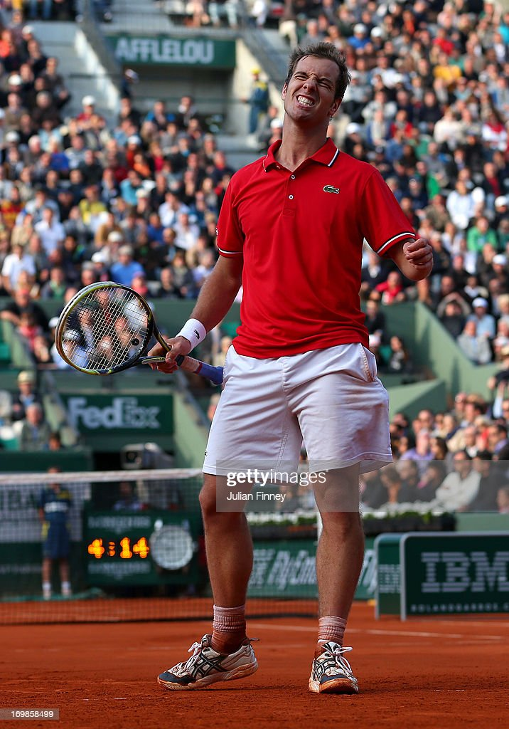 <a gi-track='captionPersonalityLinkClicked' href=/galleries/search?phrase=Richard+Gasquet&family=editorial&specificpeople=206501 ng-click='$event.stopPropagation()'>Richard Gasquet</a> of France reacts during his Men's Singles match against Stanislas Wawrinka of Switzerland on day nine of the French Open at Roland Garros on June 3, 2013 in Paris, France.