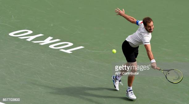 Richard Gasquet of France returns a shot against Lu YenHsun of Taiwan during their men's singles second round match of the Japan Open tennis...