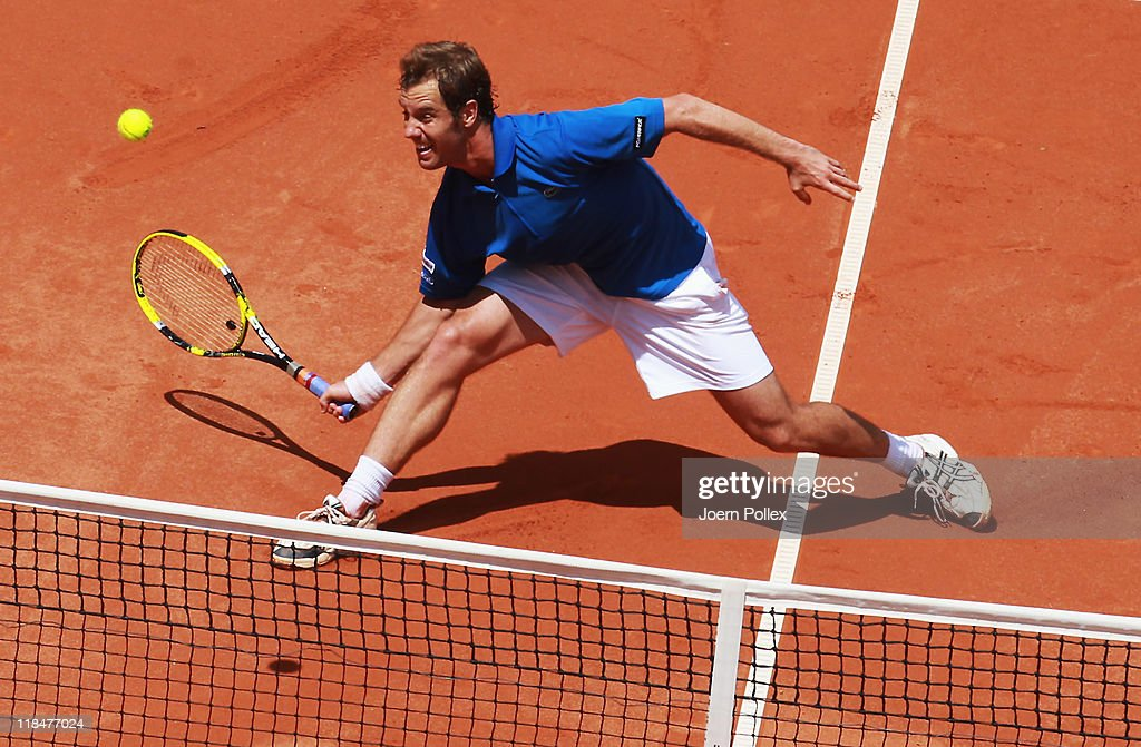 <a gi-track='captionPersonalityLinkClicked' href=/galleries/search?phrase=Richard+Gasquet&family=editorial&specificpeople=206501 ng-click='$event.stopPropagation()'>Richard Gasquet</a> of France returns the ball to Florian Mayer of Germany during the quarter-finals match in the Davis Cup World Group at Tennis club Weissenhof on July 8, 2011 in Stuttgart, Germany.