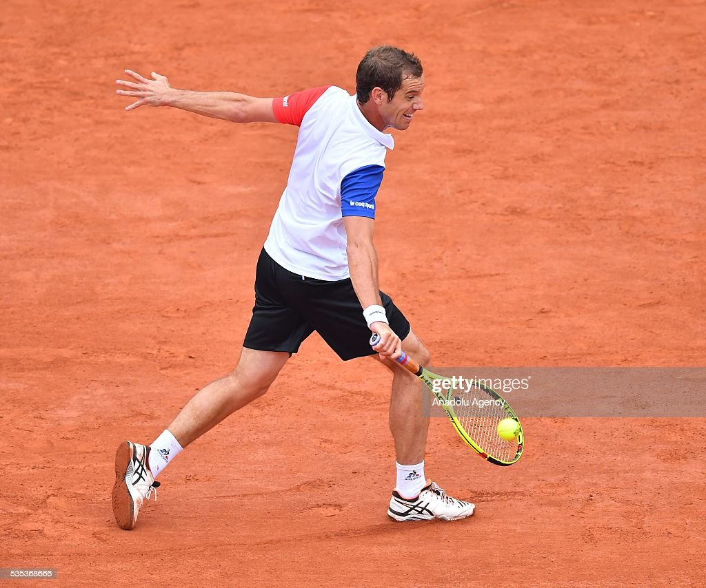 Richard Gasquet of France returns to Kei Nishikori of Japan during the men's single fourth round match at the French Open tennis tournament at Roland Garros Stadium in Paris, France on May 29, 2016.