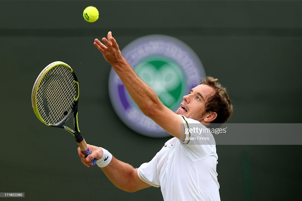 <a gi-track='captionPersonalityLinkClicked' href=/galleries/search?phrase=Richard+Gasquet&family=editorial&specificpeople=206501 ng-click='$event.stopPropagation()'>Richard Gasquet</a> of France serves during his Gentlemen's Singles second round match against Go Soeda of Japan on day four of the Wimbledon Lawn Tennis Championships at the All England Lawn Tennis and Croquet Club on June 27, 2013 in London, England.