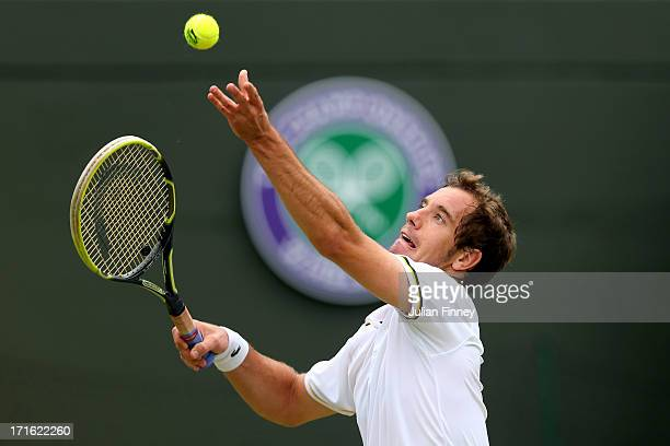 Richard Gasquet of France serves during his Gentlemen's Singles second round match against Go Soeda of Japan on day four of the Wimbledon Lawn Tennis...