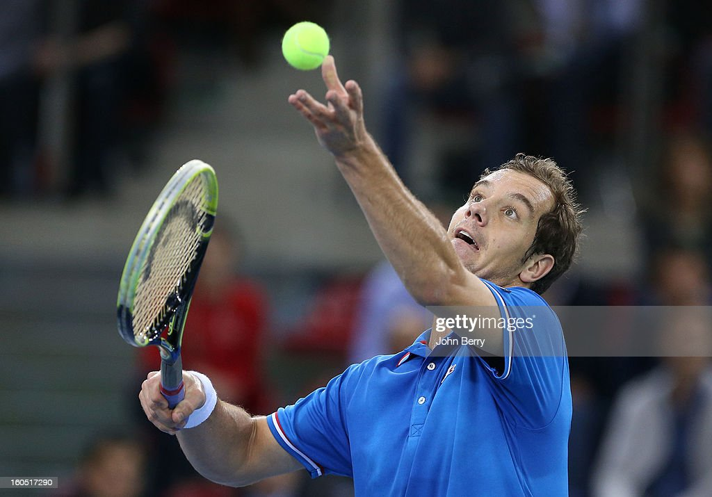 Richard Gasquet of France serves during his match against Dudi Sela of Israel on day one of the Davis Cup first round match between France and Israel at the Kindarena stadium on February 1, 2013 in Rouen, France.