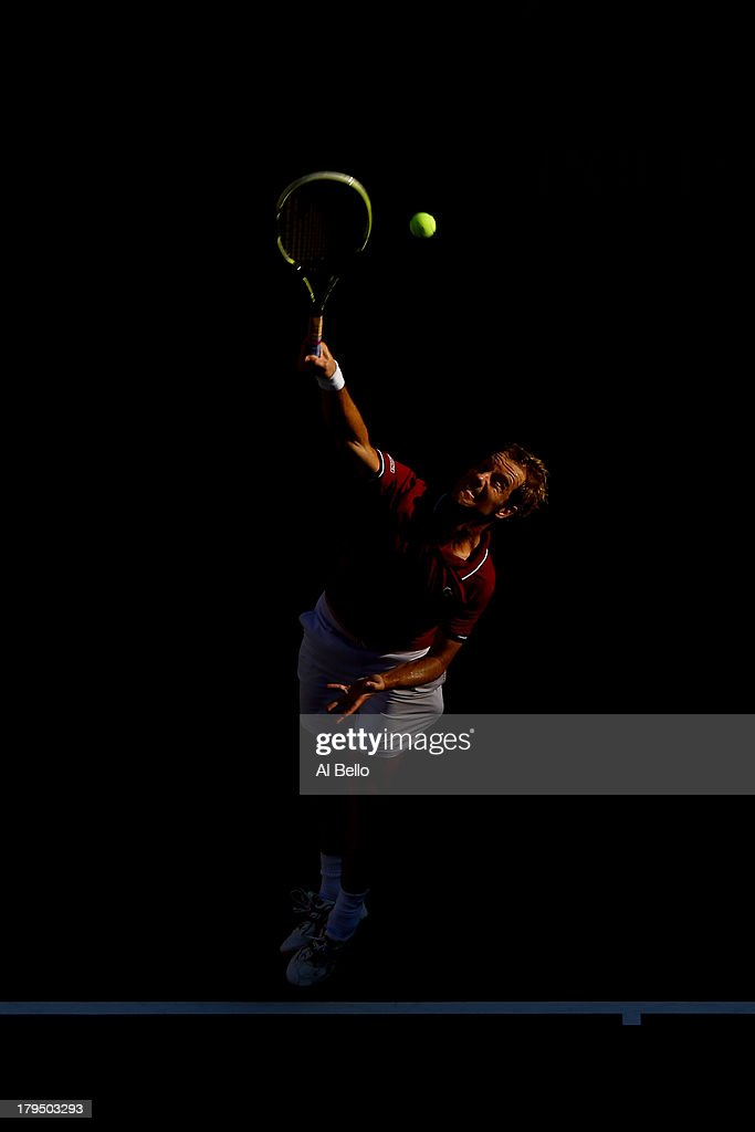 <a gi-track='captionPersonalityLinkClicked' href=/galleries/search?phrase=Richard+Gasquet&family=editorial&specificpeople=206501 ng-click='$event.stopPropagation()'>Richard Gasquet</a> of France serves during his men's singles quarter-final match against David Ferrer of Spain on Day Ten of the 2013 US Open at USTA Billie Jean King National Tennis Center on September 4, 2013 in the Flushing neighborhood of the Queens borough of New York City.