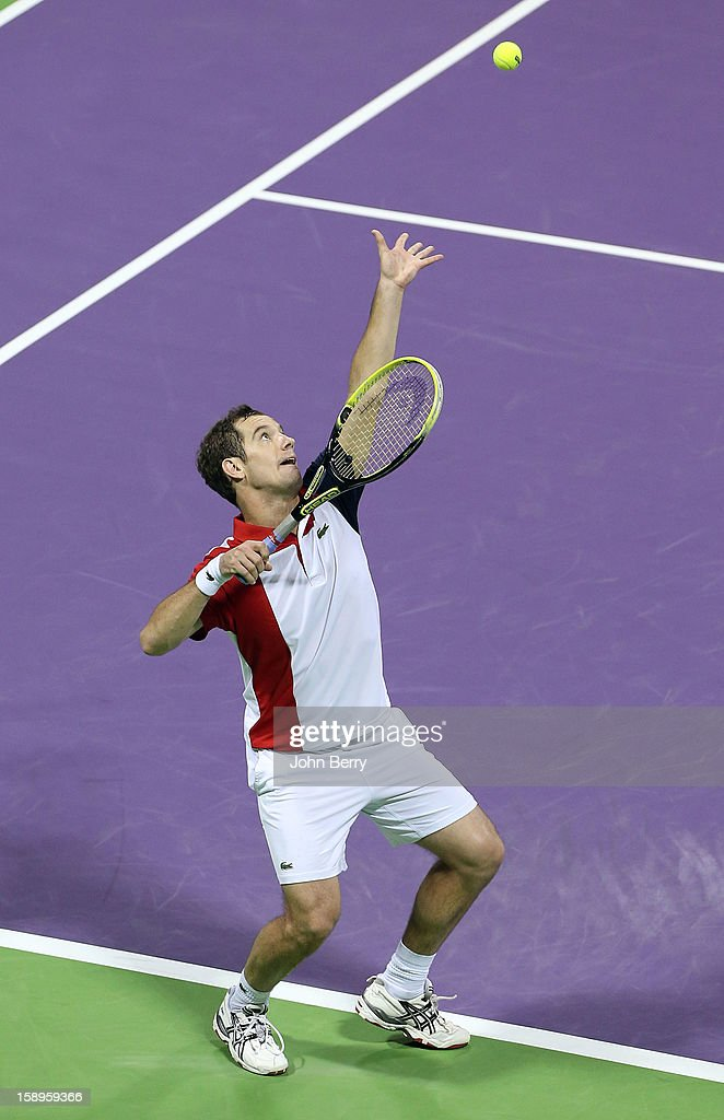 <a gi-track='captionPersonalityLinkClicked' href=/galleries/search?phrase=Richard+Gasquet&family=editorial&specificpeople=206501 ng-click='$event.stopPropagation()'>Richard Gasquet</a> of France serves during his semi-final against Daniel Brands of Germany in day five of the Qatar Open 2013 at the Khalifa International Tennis and Squash Complex on January 4, 2013 in Doha, Qatar.