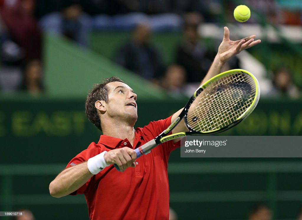 <a gi-track='captionPersonalityLinkClicked' href=/galleries/search?phrase=Richard+Gasquet&family=editorial&specificpeople=206501 ng-click='$event.stopPropagation()'>Richard Gasquet</a> of France serves during the final against Nikolay Davydenko of Russia on day six of the Qatar Open 2013 at the Khalifa International Tennis and Squash Complex on January 5, 2013 in Doha, Qatar.