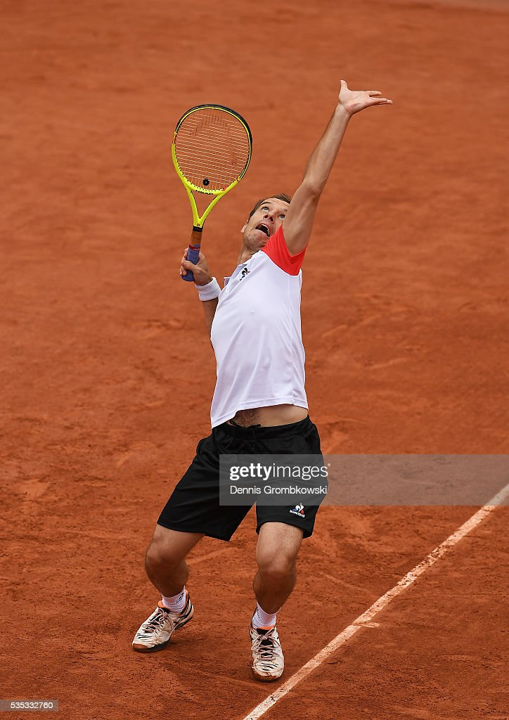 <a gi-track='captionPersonalityLinkClicked' href=/galleries/search?phrase=Richard+Gasquet&family=editorial&specificpeople=206501 ng-click='$event.stopPropagation()'>Richard Gasquet</a> of France serves during the Men's Singles fourth round match against Kei Nishikori of Japan on day eight of the 2016 French Open at Roland Garros on May 29, 2016 in Paris, France.