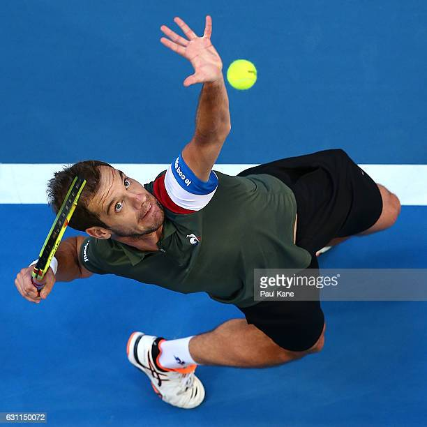 Richard Gasquet of France serves to Jack Sock of the United States in the men's singles match during the 2017 Hopman Cup Final at Perth Arena on...