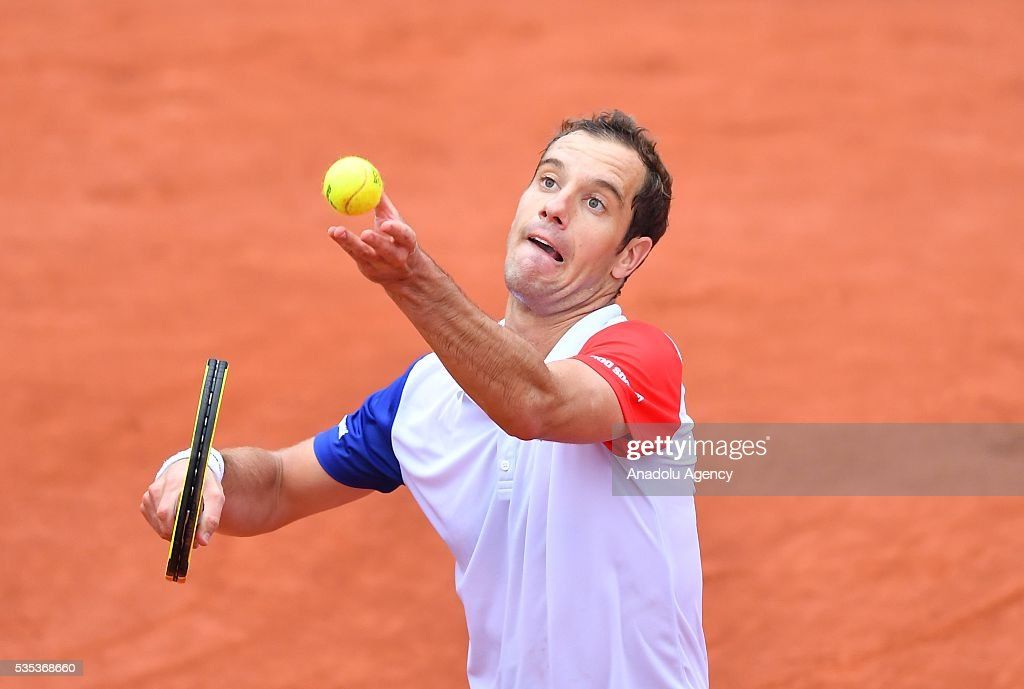 Richard Gasquet of France serves to Kei Nishikori of Japan during the men's single fourth round match at the French Open tennis tournament at Roland Garros Stadium in Paris, France on May 29, 2016.