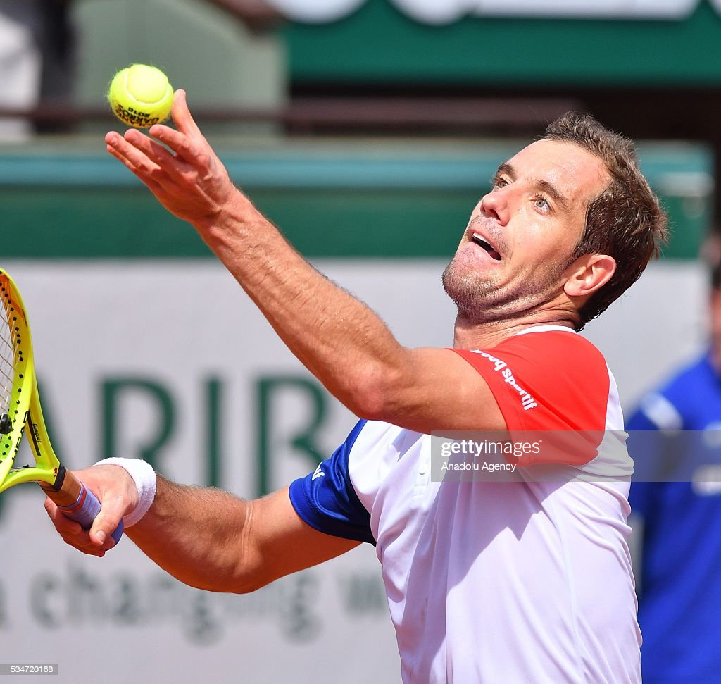 Richard Gasquet of France serves to Nick Kyrgios (not seen) of Australia during the men's single third round match at the French Open tennis tournament at Roland Garros Stadium in Paris, France on May 27, 2016.