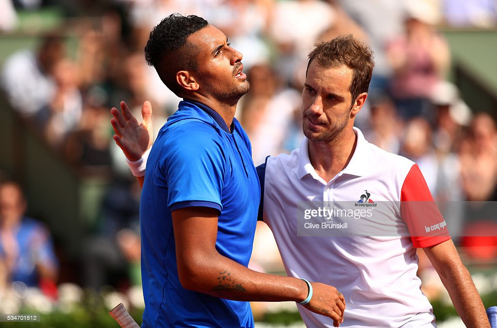 Richard Gasquet of France shakes hands with a dejected Nick Kyrgios of Australia following his victory during the Men's Singles third round match on day six of the 2016 French Open at Roland Garros on May 27, 2016 in Paris, France.