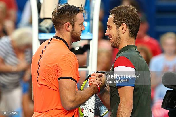 Richard Gasquet of France shakes hands with Jack Sock of the United States after winning the men's singles match during the 2017 Hopman Cup Final at...