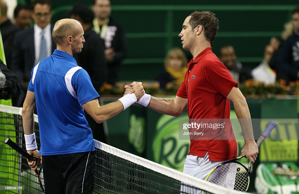 <a gi-track='captionPersonalityLinkClicked' href=/galleries/search?phrase=Richard+Gasquet&family=editorial&specificpeople=206501 ng-click='$event.stopPropagation()'>Richard Gasquet</a> of France shakes hands with <a gi-track='captionPersonalityLinkClicked' href=/galleries/search?phrase=Nikolay+Davydenko&family=editorial&specificpeople=178192 ng-click='$event.stopPropagation()'>Nikolay Davydenko</a> of Russia after the final in day six of the Qatar Open 2013 at the Khalifa International Tennis and Squash Complex on January 5, 2013 in Doha, Qatar.