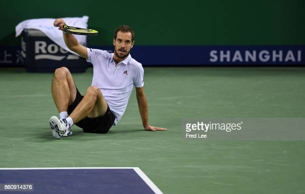 Richard Gasquet of France slips fall during agains the match against Roger Federer of Switzerland on Day 6 during Men's Single QuaterFinal of 2017...