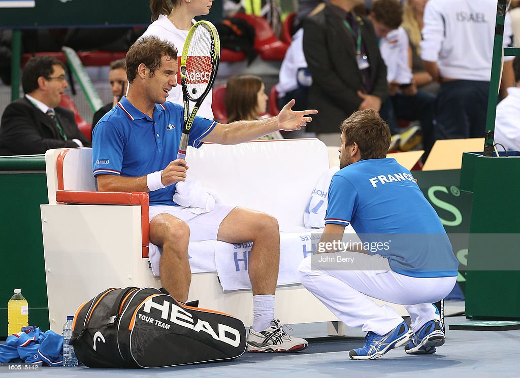 Richard Gasquet of France speaks to France coach Arnaud Clement during his match against Dudi Sela of Israel on day one of the Davis Cup first round match between France and Israel at the Kindarena stadium on February 1, 2013 in Rouen, France.