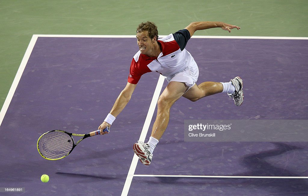 Richard Gasquet of France stretches to play a forehand volley against Andy Murray of Great Britain during their semi final match at the Sony Open at Crandon Park Tennis Center on March 29, 2013 in Key Biscayne, Florida.