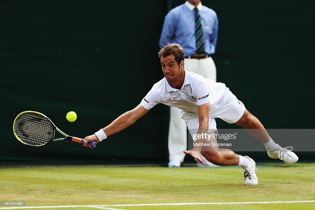 <a gi-track='captionPersonalityLinkClicked' href=/galleries/search?phrase=Richard+Gasquet&family=editorial&specificpeople=206501 ng-click='$event.stopPropagation()'>Richard Gasquet</a> of France stretches to reach for a return shot during his Gentlemen's Singles second round match against Nick Kyrgios of Australia on day four of the Wimbledon Lawn Tennis Championships at the All England Lawn Tennis and Croquet Club at Wimbledon on June 26, 2014 in London, England.