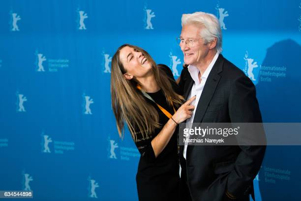 Richard Gere and an employee of the Berlinale attends the 'The Dinner' photo call during the 67th Berlinale International Film Festival Berlin at...