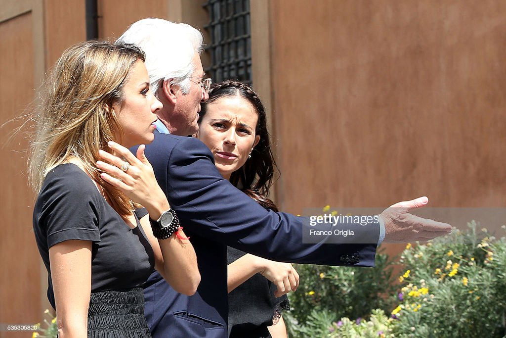 <a gi-track='captionPersonalityLinkClicked' href=/galleries/search?phrase=Richard+Gere&family=editorial&specificpeople=202110 ng-click='$event.stopPropagation()'>Richard Gere</a> and his girlfriend <a gi-track='captionPersonalityLinkClicked' href=/galleries/search?phrase=Alejandra+Silva&family=editorial&specificpeople=15061811 ng-click='$event.stopPropagation()'>Alejandra Silva</a> arrive at 'Un Muro o Un Ponte' Seminary held by Pope Francis at the Paul VI Hall on May 29, 2016 in Vatican City, Vatican.