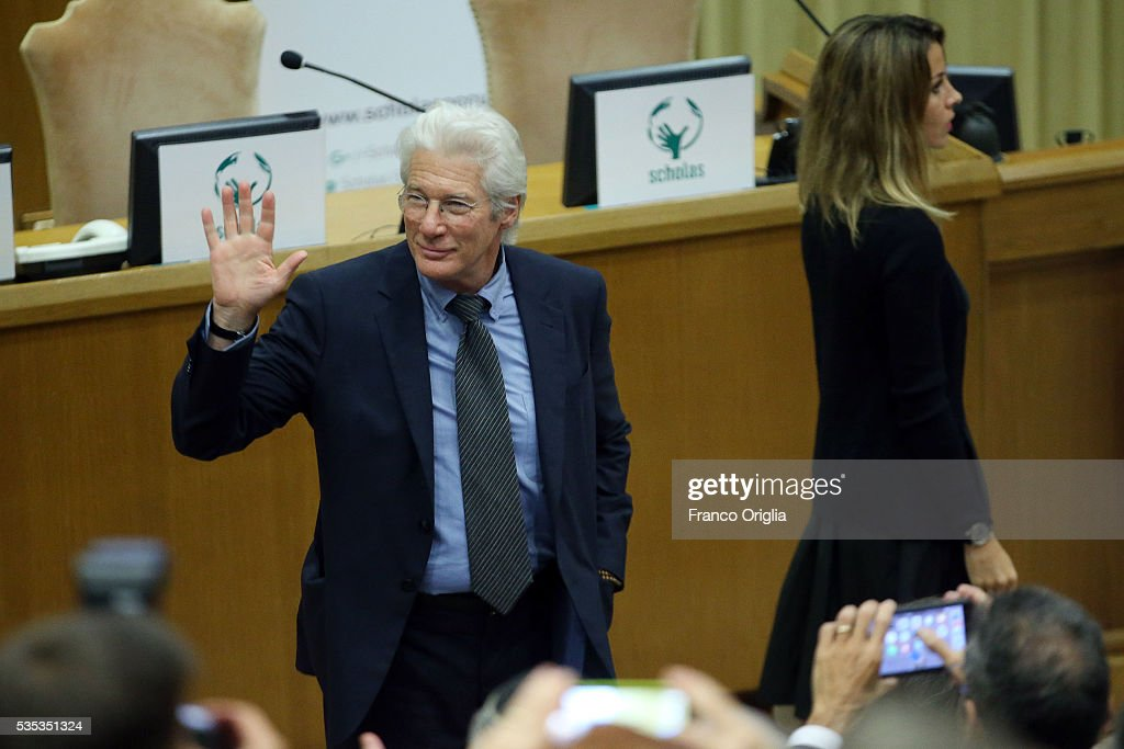 <a gi-track='captionPersonalityLinkClicked' href=/galleries/search?phrase=Richard+Gere&family=editorial&specificpeople=202110 ng-click='$event.stopPropagation()'>Richard Gere</a> and his girlfriend <a gi-track='captionPersonalityLinkClicked' href=/galleries/search?phrase=Alejandra+Silva&family=editorial&specificpeople=15061811 ng-click='$event.stopPropagation()'>Alejandra Silva</a> attend 'Un Muro o Un Ponte' Seminary held by Pope Francis at the Paul VI Hall on May 29, 2016 in Vatican City, Vatican.