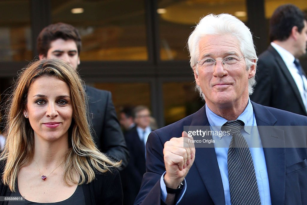 Richard Gere and his girlfriend Alejandra Silva leave at the end of 'Un Muro o Un Ponte' Seminary held by Pope Francis at the Paul VI Hall on May 29, 2016 in Vatican City, Vatican.