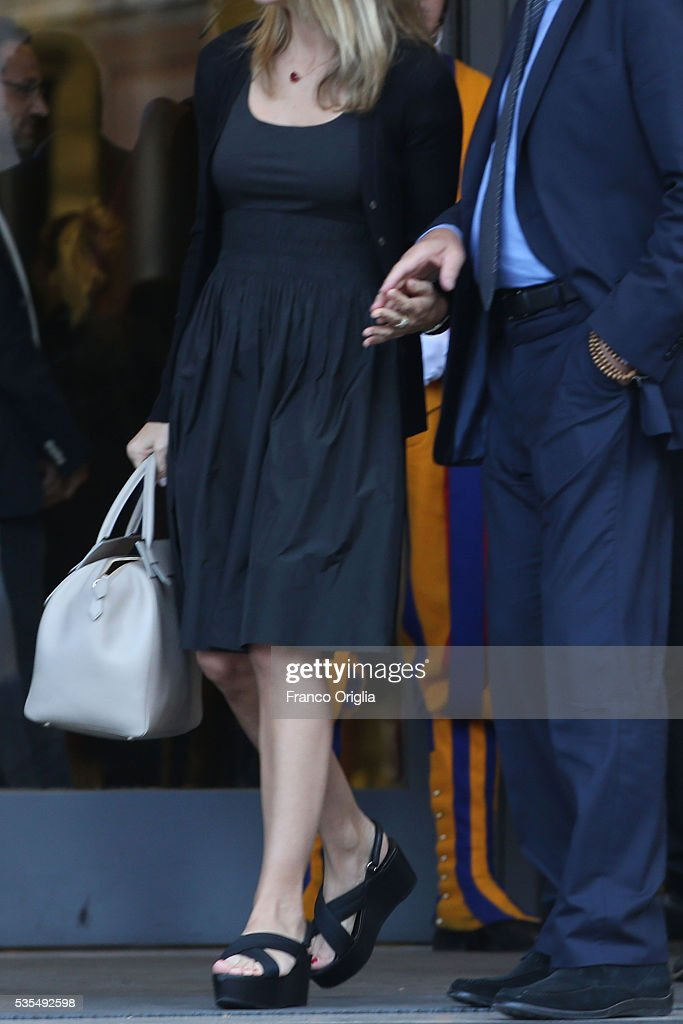 Richard Gere and his girlfriend Alejandra Silva (bag and shoes detail) leave at the end of 'Un Muro o Un Ponte' Seminary held by Pope Francis at the Paul VI Hall on May 29, 2016 in Vatican City, Vatican.