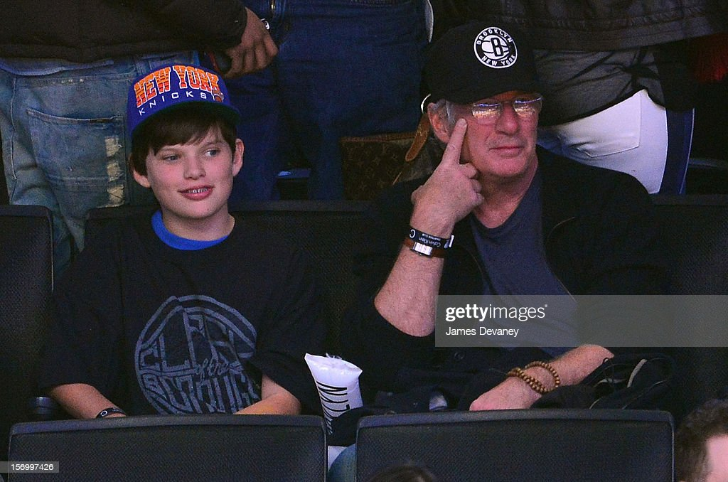 <a gi-track='captionPersonalityLinkClicked' href=/galleries/search?phrase=Richard+Gere&family=editorial&specificpeople=202110 ng-click='$event.stopPropagation()'>Richard Gere</a> (R) and son Homer attend the New York Knicks v Brooklyn Nets game at Barclays Center on November 26, 2012 in the Brooklyn borough of New York City.