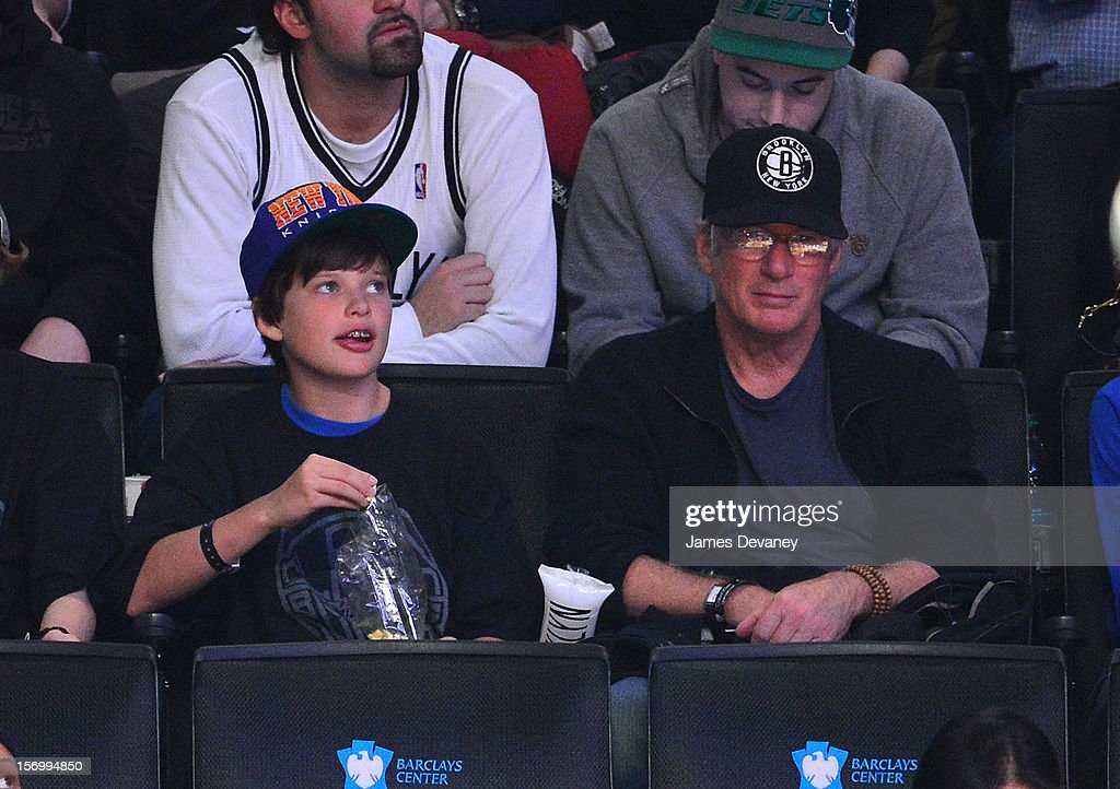 Richard Gere and son Homer James attend the New York Knicks vs Brooklyn Nets game at Barclays Center on November 26, 2012 in the Brooklyn borough of New York City.