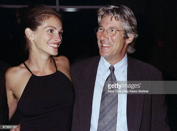 Richard Gere gets together with actress Julia Roberts at Amnesty International USA's Second Annual Media Spotlight Awards dinner Gere received a...