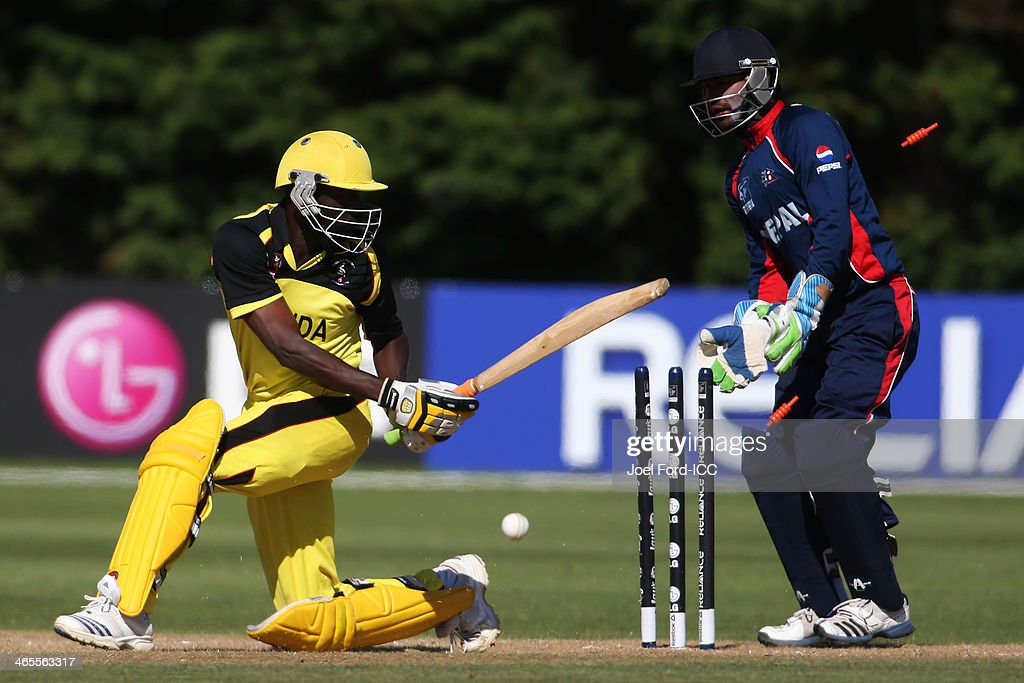 Richard Gideon Okia of Uganda is bowled out during an ICC World Cup qualifying playoff between Uganda and Nepal on January 28, 2014 in Mount Maunganui, New Zealand.