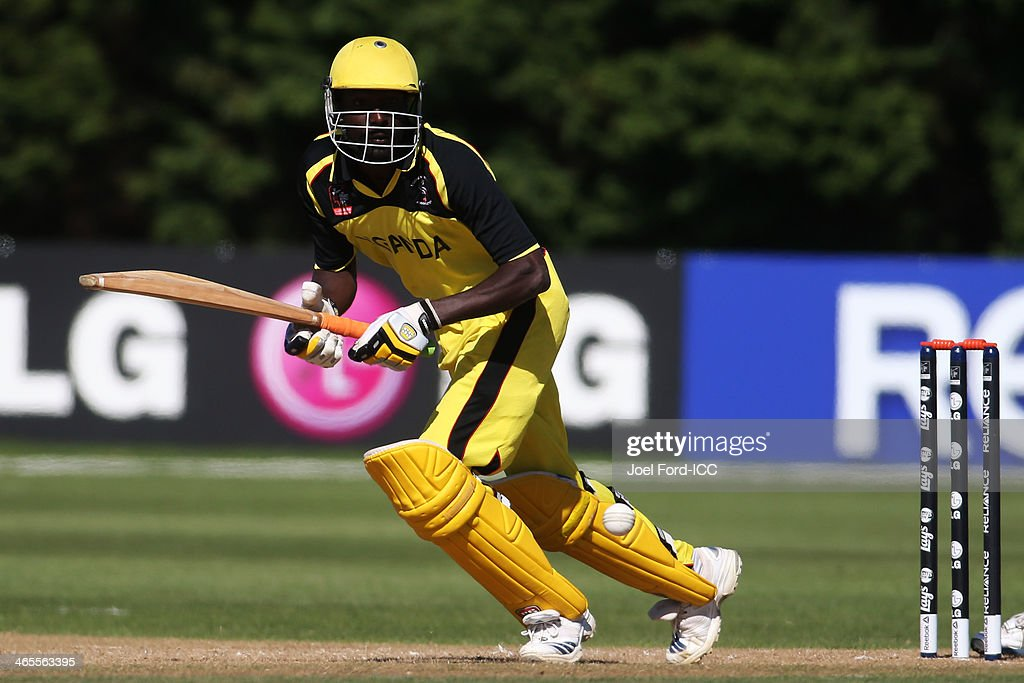 Richard Gideon Okia of Uganda plays a shot during an ICC World Cup qualifying playoff between Uganda and Nepal on January 28, 2014 in Mount Maunganui, New Zealand.