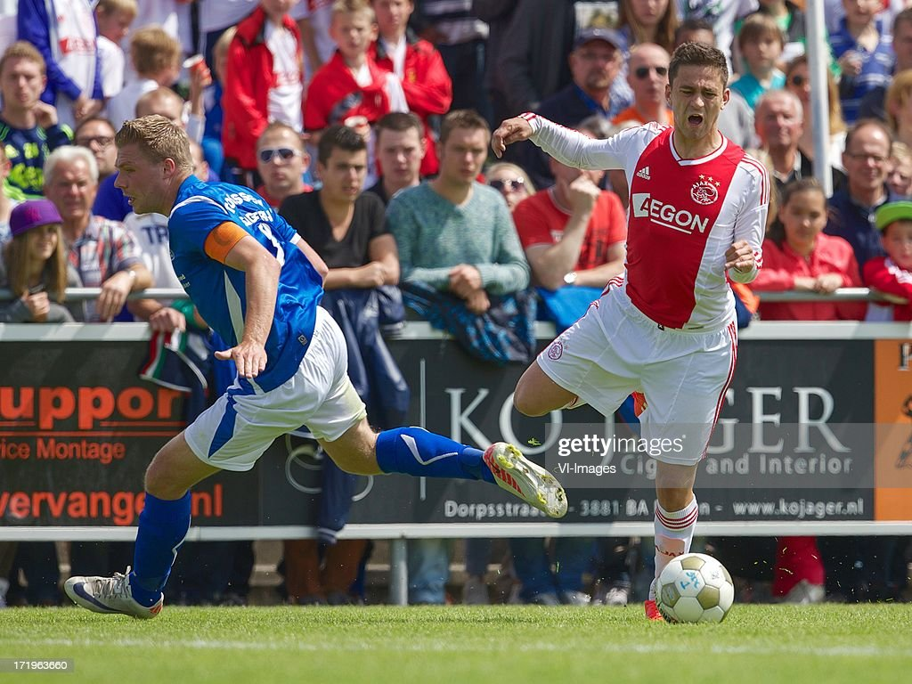 Richard Gooijer of SDC Putten, Dejan Meleg of Ajax during the pre season friendly match between SDC Putten and Ajax on June 29, 2013 in Putten, The Netherlands.