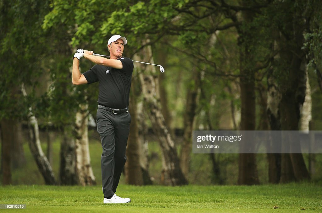 Richard Green of Australia hits an approach during day one of the BMW PGA Championship at Wentworth on May 22 2014 in Virginia Water England
