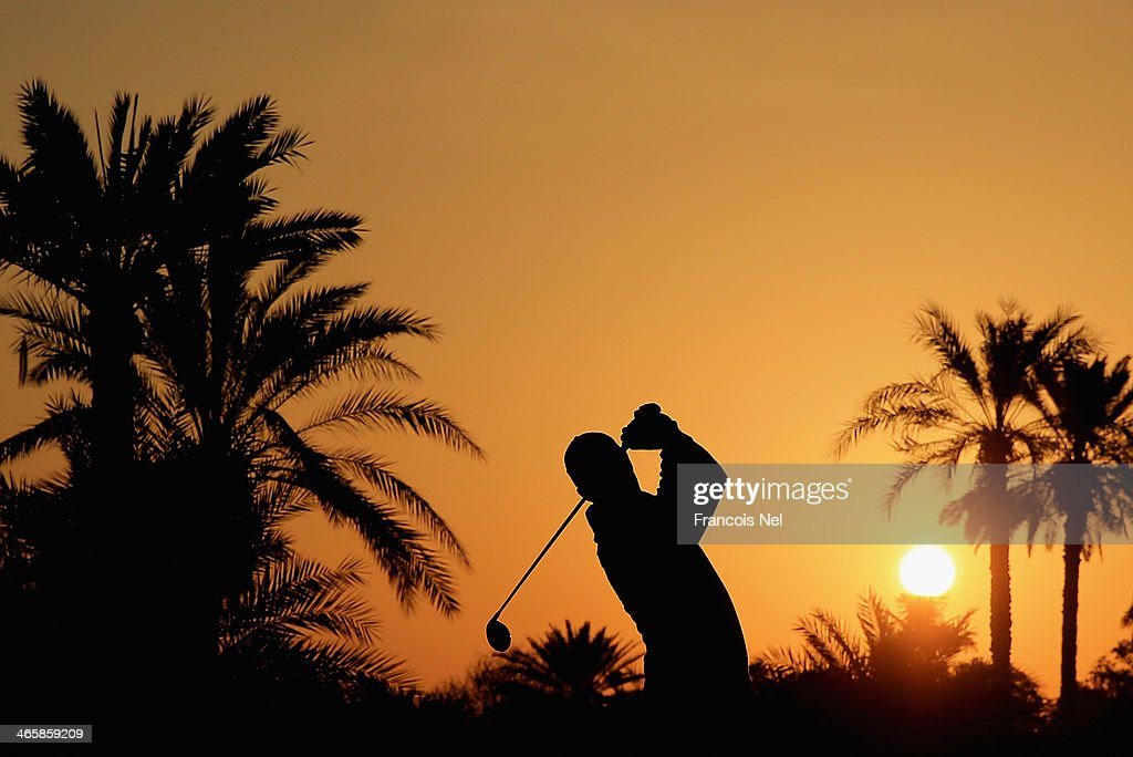 Richard Green of Australia plays his second shot on the the 10th hole during the first round of the 2014 Omega Dubai Desert Classic on the Majlis...