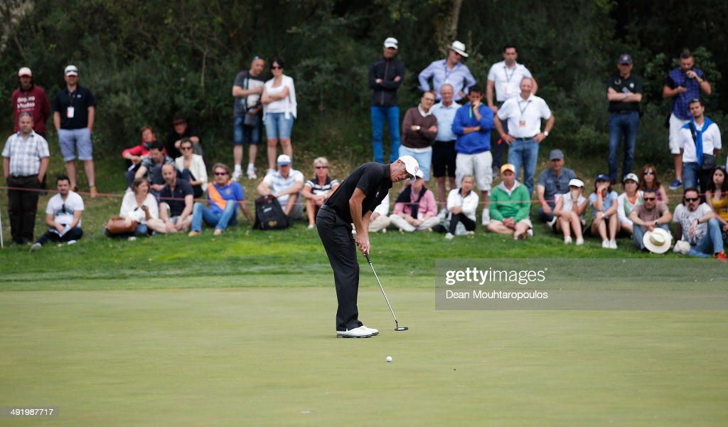 Richard Green of Australia putts on the 13th green during the final round of the Open de Espana held at PGA Catalunya Resort on May 18 2014 in Girona...