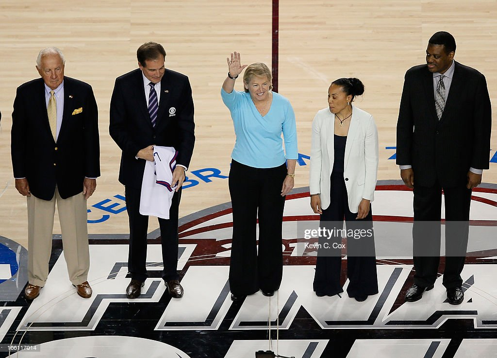 Richard Guerin, Jim Nantz (holding a Jersey representing Guy Lewis), Sylvia Hatchell, Dawn Staley and Bernard King stand on the court as the Naismith Memorial Basketball Hall of Fame 2013 Class On Court Announcement is made during the 2013 NCAA Men's Final Four Championship between the Michigan Wolverines and the Louisville Cardinals at the Georgia Dome on April 8, 2013 in Atlanta, Georgia.