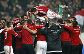 Richard Guzmics of Hungary celebrates with teammates the qualification of Hungary for EURO 2016 after the victory in the UEFA EURO 2016 qualifier...