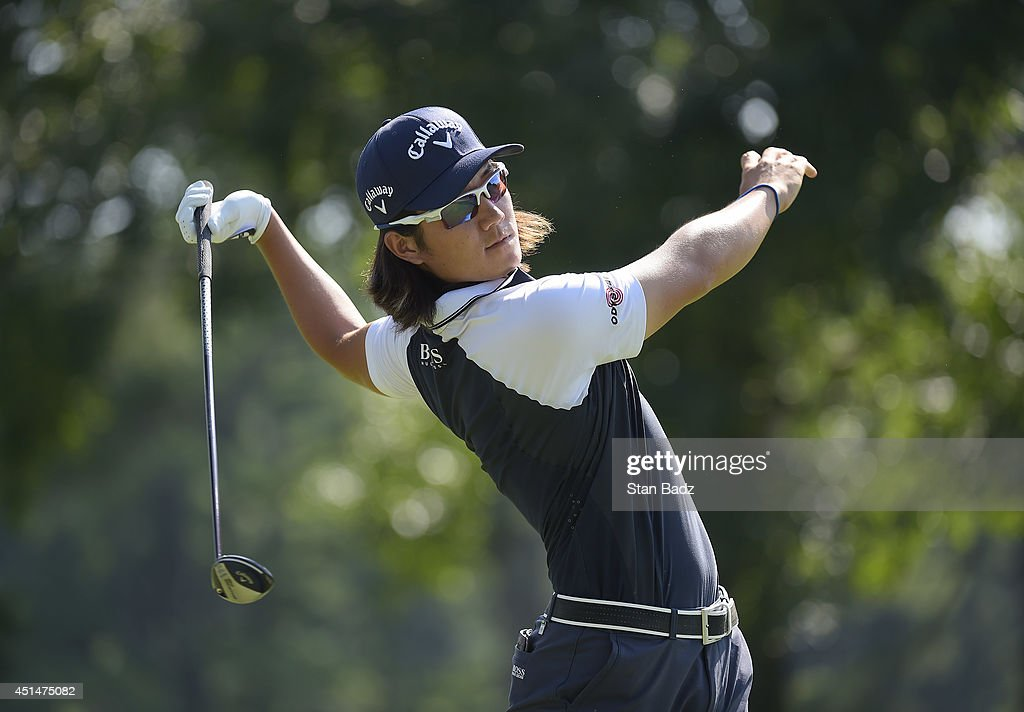Richard H. Lee looses his grip following his tee shot on the 12th hole during the final round of the Quicken Loans National at Congressional Country Club on June 29, 2014 in Bethesda, Maryland.