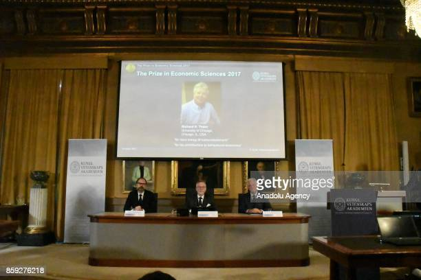 Richard H Thaler is seen on a screen as Secretary General of the Royal Swedish Academy of Sciences Goran K Hansson announces the winner of the...