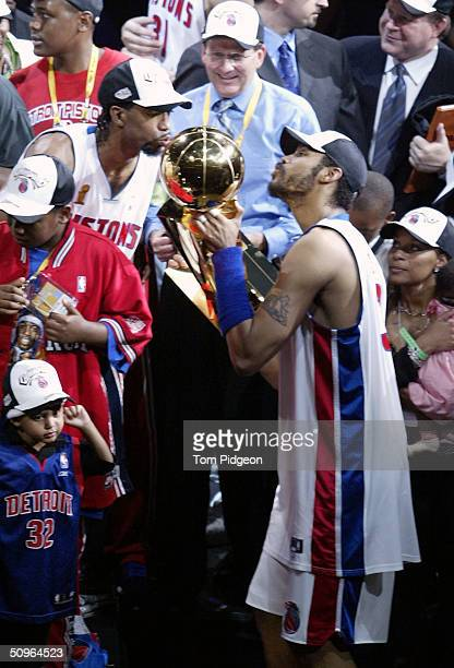Richard Hamilton and Rasheed Wallace of the Detroit Pistons celebrate by kissing the Larry O'Brien NBA Championship trophy after defeating the Los...