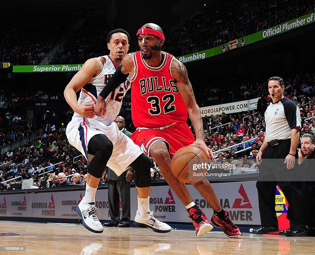Richard Hamilton #32 of the Chicago Bulls drives to the basket against John Jenkins #12 of the Atlanta Hawks on February 2, 2013 at Philips Arena in Atlanta, Georgia.