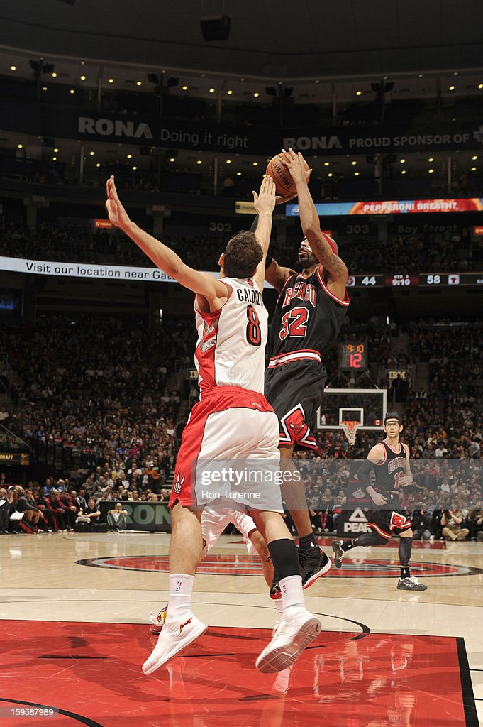 Richard Hamilton #32 of the Chicago Bulls goes for a jump shot against Jose Calderon #8 of the Toronto Raptors during the game between the Toronto Raptors and the Chicago Bulls on January 16, 2013 at the Air Canada Centre in Toronto, Ontario, Canada.