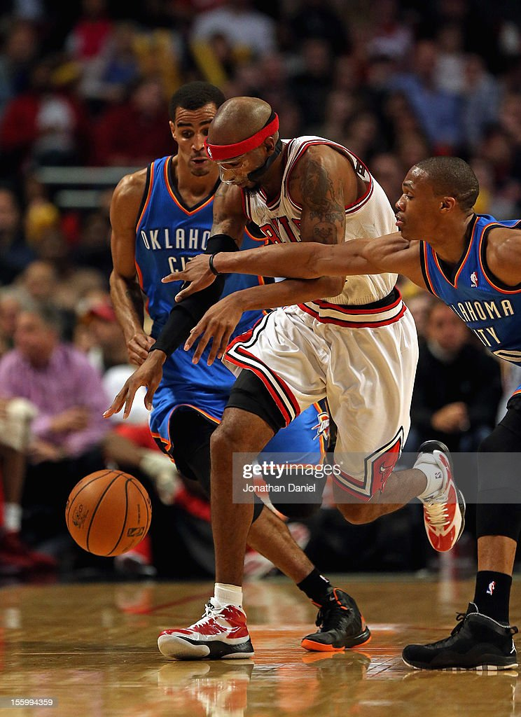 Richard Hamilton #32 of the Chicago Bulls is fouled by <a gi-track='captionPersonalityLinkClicked' href=/galleries/search?phrase=Russell+Westbrook&family=editorial&specificpeople=4044231 ng-click='$event.stopPropagation()'>Russell Westbrook</a> #0 of the Oklahoma City Thunder at the United Center on November 8, 2012 in Chicago, Illinois.The Thunder defeated the Bulls 97-91.